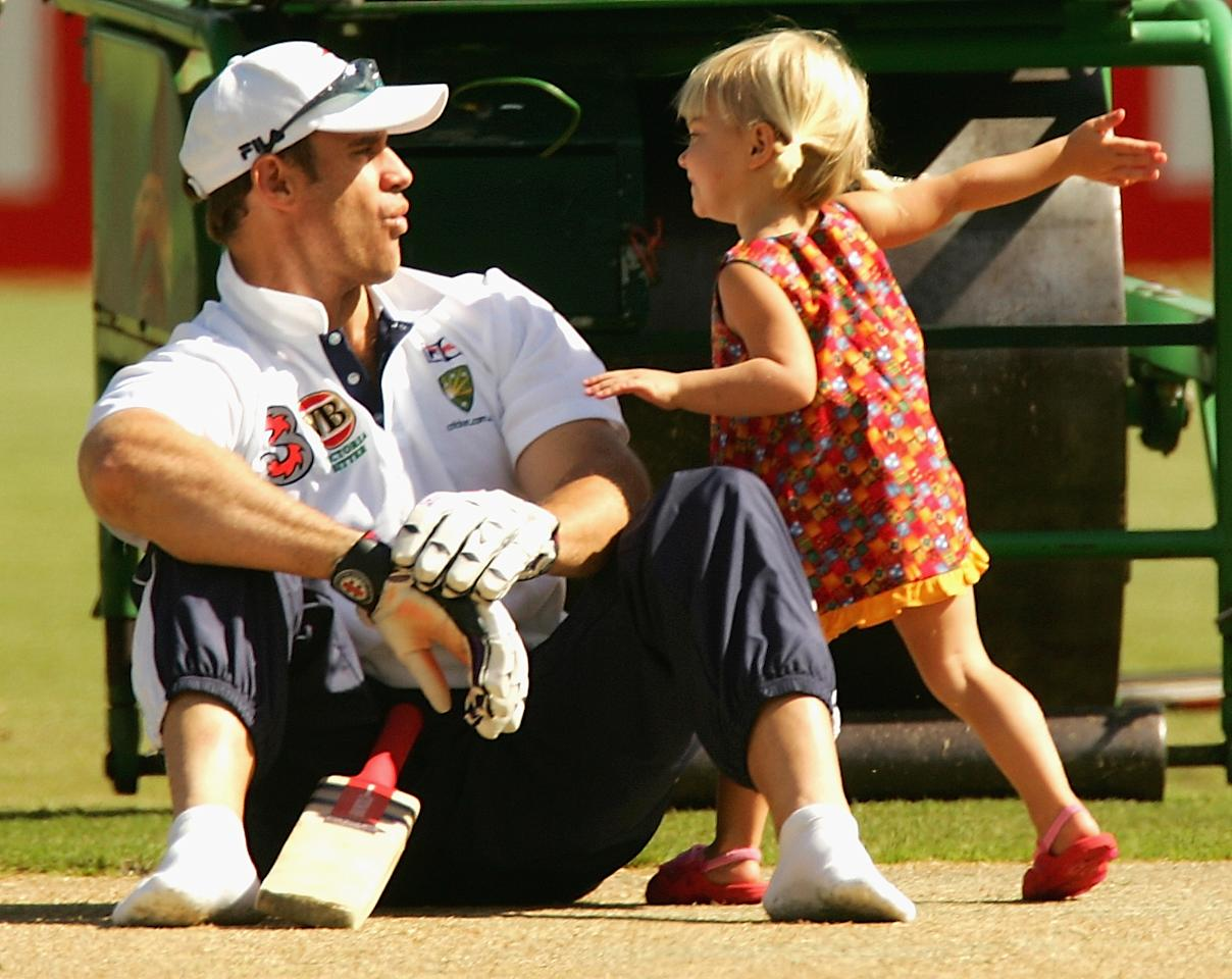 MELBOURNE, AUSTRALIA - DECEMBER 25:  Matthew Hayden of Australia receives a playful blow from daughter Grace while out on the pitch during training at the MCG on December 25, 2004 in Melbourne, Australia.  (Photo by Hamish Blair/Getty Images)