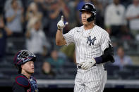 New York Yankees' Aaron Judge gestures as he scores on a solo home run off Cleveland Indians starting pitcher Zach Plesac during the fourth inning of a baseball game Friday, Sept. 17, 2021, in New York. (AP Photo/John Minchillo)