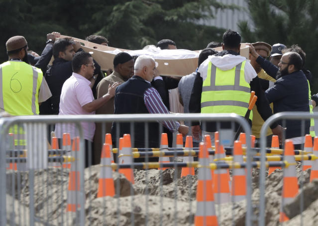 In this Wednesday, March 20, 2019, file photo, mourners carry the body of a victim of the Friday March 15 mosque shootings for a burial at the Memorial Park Cemetery in Christchurch, New Zealand. (AP Photo/Mark Baker, File)