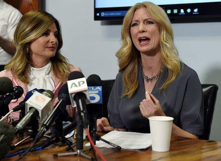 Radio-TV personality Wendy Walsh (R) speaks with reporters alongside her attorney, Lisa Bloom, to discuss her allegations of sexual harassment by Fox News host Bill O'Reilly, during a news conference in Los Angeles, California, U.S., April 3, 2017. REUTERS/Kevork Djansezian