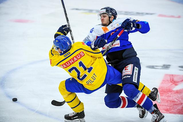 Ice Hockey - 2018 Euro Hockey Challenge - Sweden v Slovakia - Oskarshamn, Sweden - April 6, 2018 - Sweden's Lawrence Pilut and Slovakia's Filip Krivosik in action. TT News Agency/Suvad Mrkonjic/via REUTERS ATTENTION EDITORS - THIS IMAGE WAS PROVIDED BY A THIRD PARTY. SWEDEN OUT. NO COMMERCIAL OR EDITORIAL SALES IN SWEDEN