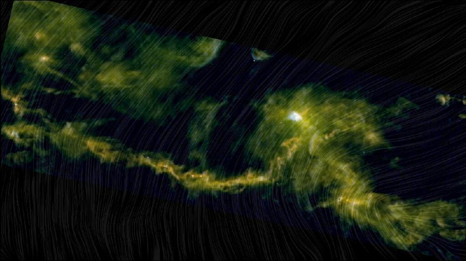 In this image, you can see a piece of the Taurus Molecular Cloud, created using data from the European Space Agency's Herschel and Planck space telescopes. The bright streaks in this picture show the emission by interstellar dust grains in different wavelengths. The draping pattern of lines shows the magnetic field orientation.