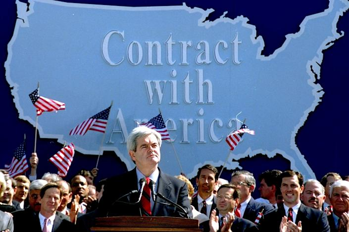 Newt Gingrich addresses Republican congressional candidates on Capitol Hill on Sept. 27, 1994, during a rally where they pledged a Contract with America.