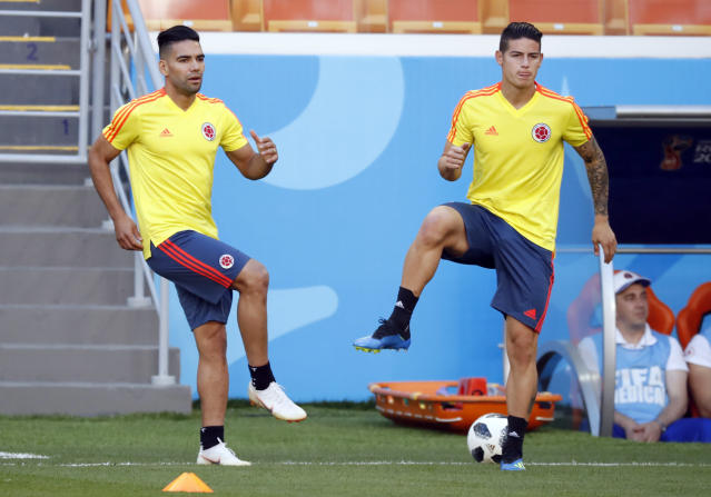 Colombia's James Rodriguez, right, and Colombia's Radamel Falcao, left, warm up during Colombia's official training on the eve of the group H match between Colombia and Japan at the 2018 soccer World Cup in the Mordavia Arena in Saransk, Russia, Monday, June 18, 2018. (AP Photo/Eugene Hoshiko)