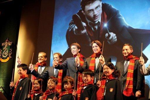 James and Oliver Phelps, who played the Weasley twins, were greeted by dozens of Harry Potter fans in Osaka