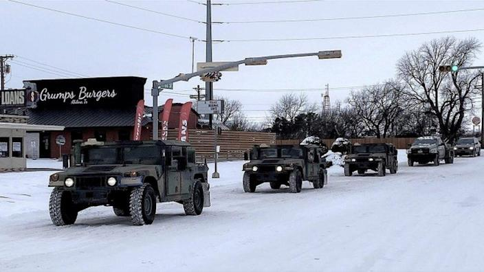 Military convoys transport Texans in Abilene to temporary warming shelters