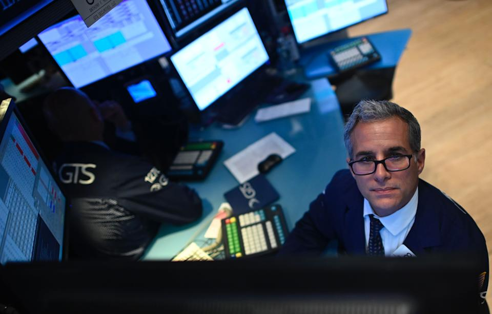 A trader works during the opening bell at the New York Stock Exchange (NYSE) on October 2, 2019 at Wall Street in New York City. - US stocks continued to fall at the markets' open on Wednesday, as disappointing employment data added to the gloom from a dismal manufacturing report on Tuesday.Tuesday's losses wiped out gains won in the third quarter by the benchmark Dow and S&P 500, and the downward slide continued. (Photo by Johannes EISELE / AFP) (Photo by JOHANNES EISELE/AFP via Getty Images)