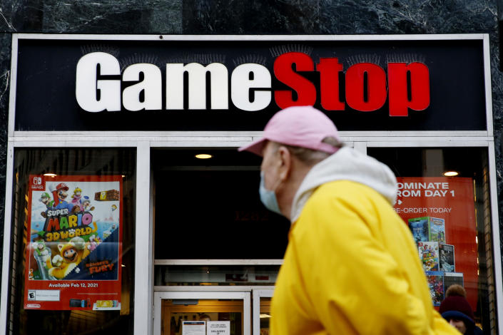NEW YORK, NEW YORK - FEBRUARY 25: A man looks at GameStop at 6th Avenue on February 25, 2021 in New York. GameStop Corp. doubled its shares and and jumped another 19 percent today and the betting are that GameStop shares would spike to $800 on Friday. (Photo by John Smith/VIEWpress via Getty Images)