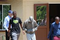 Paralympic Athlete Oscar Pistorius leaves the Boshkop Police Station following his arrest for allegedly shooting and killing his girlfriend.