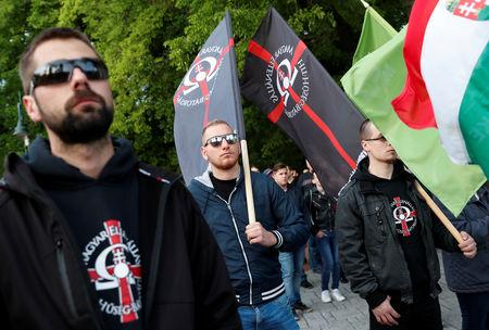 Members of far-right, nationalist groups attend a protest against criminal attacks caused by youth, in Torokszentmiklos, Hungary, May 21, 2019. REUTERS/Bernadett Szabo