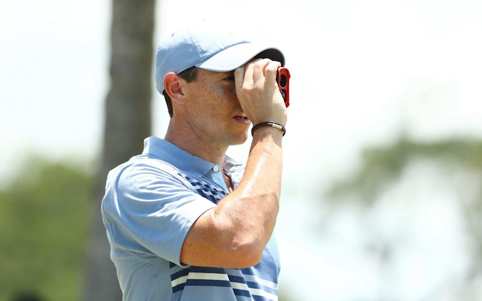 Rory McIlroy of the American Nurses Foundation team uses a rangefinder in practice - Mike Ehrmann/Getty Images