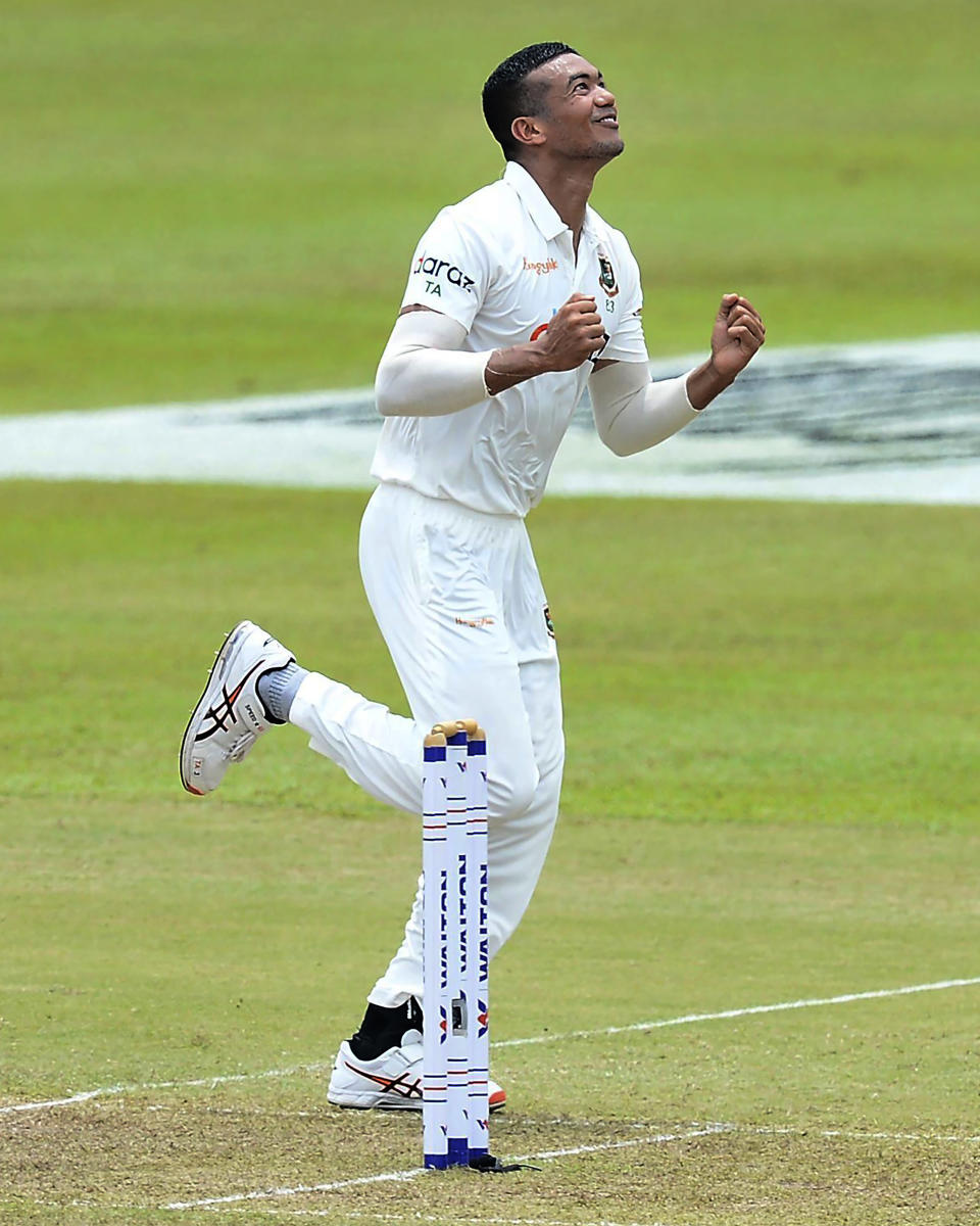 Bangladesh's Taskin Ahmed celebrates the dismissal of Sri Lanka's Lahiru Thirimanne during the second day of the second test cricket match between Sri Lanka and Bangladesh in Pallekele, Sri Lanka, Friday, April 30, 2021.( AP Photo/Sameera Peiris)
