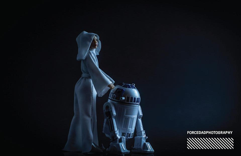 """<p>""""After the passing of Carrie Fisher there was some fantastic fan art celebrating her (and Kenny Baker's) life. There was one that touched me titled <em>A Princess Is Once United With Her Astromech… </em>and I wanted to recreate it in a dramatic way. Even though it isn't a scene in any <em>Star Wars</em> movie, I wanted to make something that evoked that image of saying goodbye to some dear friends."""" (Photo: <a href=""""https://www.instagram.com/forcedadphotography/"""" rel=""""nofollow noopener"""" target=""""_blank"""" data-ylk=""""slk:@forcedadphotography"""" class=""""link rapid-noclick-resp"""">@forcedadphotography</a>/Hasbro) </p>"""