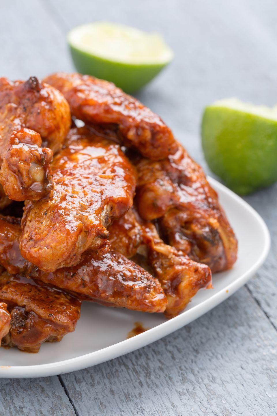 """<p>Don't underestimate the powerful heat of chipotle peppers: If you're the type who thinks Sriracha is spicy enough, these wings are not for you. Squeeze them with extra lime to tame the flame.</p><p>Get the recipe from <a href=""""/cooking/recipe-ideas/recipes/a44371/slow-cooker-chipotle-lime-chicken-wings-recipe/"""" data-ylk=""""slk:Delish"""" class=""""link rapid-noclick-resp"""">Delish</a>.</p><p><strong><em>More into the food than the game? We have the perfect <a href=""""https://shop.delish.com/products/here-for-the-food-t-shirt"""" rel=""""nofollow noopener"""" target=""""_blank"""" data-ylk=""""slk:t-shirt"""" class=""""link rapid-noclick-resp"""">t-shirt</a> for you.</em></strong></p>"""