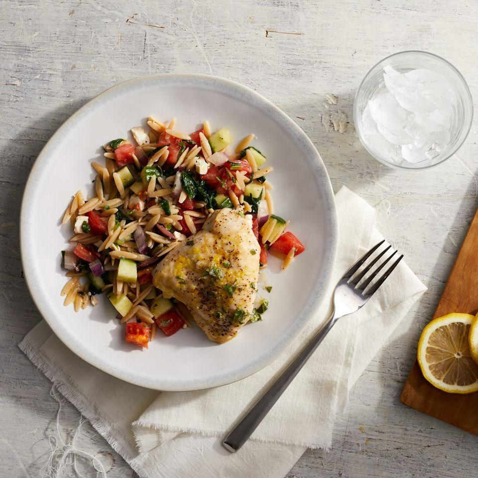"""<p>Baked chicken breasts cook in the oven while you mix together a Mediterranean salad--packed with veggies, whole-wheat orzo and an easy homemade Greek vinaigrette--for a weekend-worthy dinner on the table in under an hour. The leftovers from this healthy 400-calorie meal make a delicious packable lunch for the next day. <a href=""""https://www.eatingwell.com/recipe/261766/mediterranean-chicken-with-orzo-salad/"""" rel=""""nofollow noopener"""" target=""""_blank"""" data-ylk=""""slk:View Recipe"""" class=""""link rapid-noclick-resp"""">View Recipe</a></p>"""