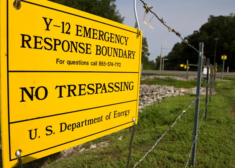 FILE - In this Aug. 17, 2012, file photo, signs warn against trespassing onto the Y-12 National Security Complex in Oak Ridge, Tenn. Three nuclear protesters, including an octogenarian nun, are scheduled to be sentenced on Tuesday, Jan. 28, 2014, for their convictions for breaking into the facility and painting slogans on the outside wall of its uranium processing plant. (AP Photo/Erik Schelzig, file)