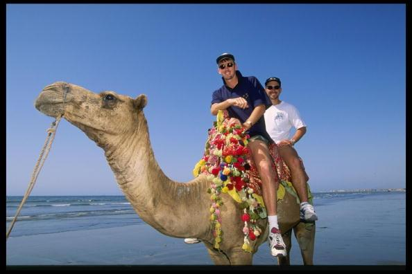 Oct 1994: Glen McGrath and Justin Langer of Australia enjoy a camel ride during Australia's tour to Pakistan.                 Mandatory Credit: Shaun Botterill/Allsport UK