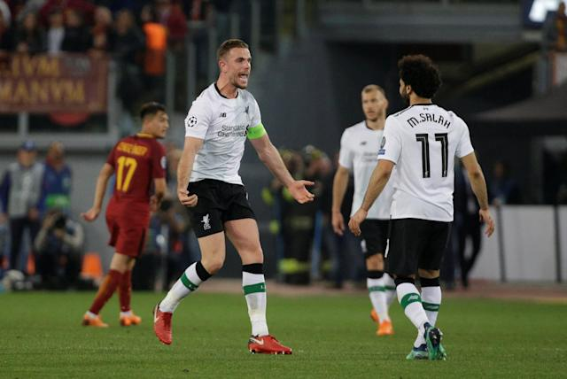 Soccer Football - Champions League Semi Final Second Leg - AS Roma v Liverpool - Stadio Olimpico, Rome, Italy - May 2, 2018 Liverpool's Jordan Henderson and Mohamed Salah celebrate after the match REUTERS/Max Rossi