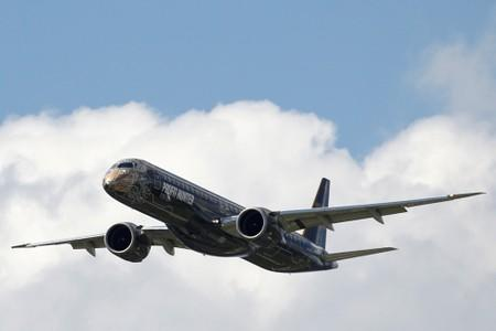 FILE PHOTO: An Embraer E195-2 performs during the 53rd International Paris Air Show at Le Bourget Airport near Paris