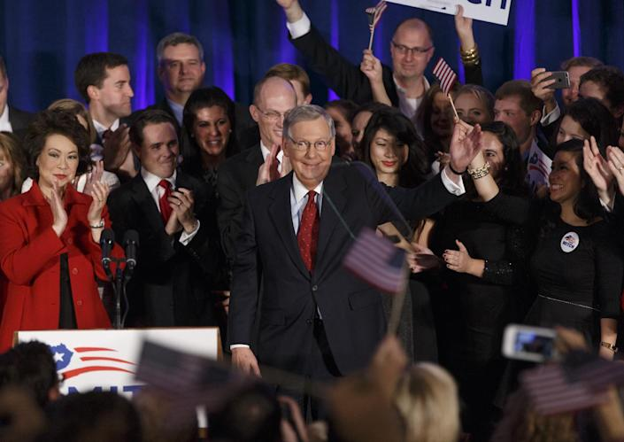 Senate Minority Leader Mitch McConnell, R-Ky., celebrates with his supporters at an election night party in Louisville, Ky., joined by his wife, former Labor Secretary Elaine Chao, left. McConnell won a sixth term in Washington. AP Photo/J. Scott Applewhite, File)