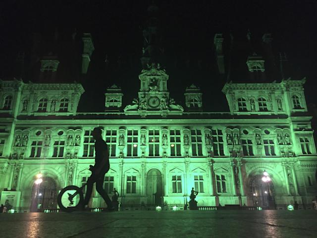 Paris' Hôtel de Ville (city hall) is illuminated in green following the announcement by President Trump that the U.S. will withdraw from the 2015 Paris accord and try to negotiate a new global deal on climate change. (Photo: Nadine Achoui-Lesage/AP)