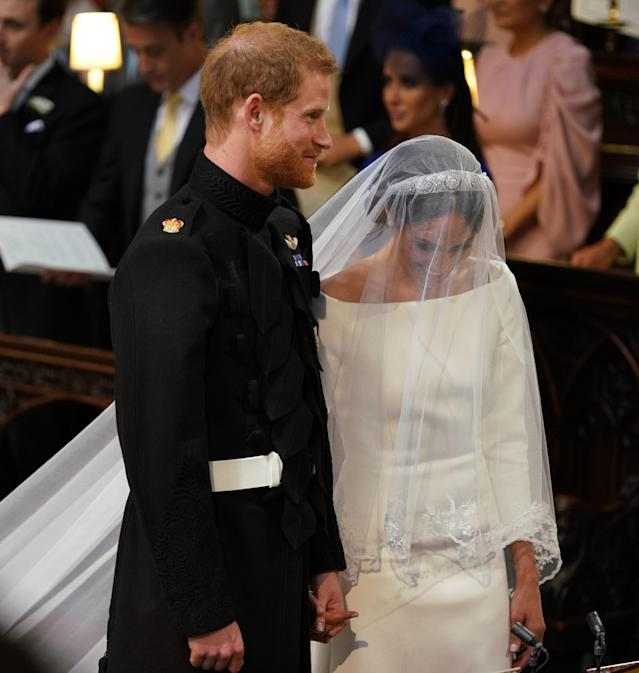 <p>Prince Harry and Meghan Markle stand together in St George's Chapel at Windsor Castle for their wedding. (Photo: Dominic Lipinski – WPA Pool/Getty Images) </p>