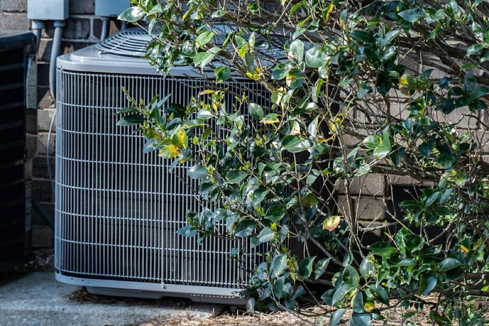 """HVAC equipment may not be the most aesthetically pleasing aspect of your home's exterior, but it's best to resist the urge to conceal it with landscaping. """"Surrounding it with plants or shrubs could block proper ventilation and clog the system,"""" explains Dawson. He recommends making sure that there's plenty of open space around your unit to prevent any issues."""