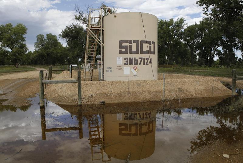 In this Wednesday, Sept. 18, 2013 photo, an oil well pump site is reflected in flood waters near Greeley, Colo. Colorado's floods shut down hundreds of natural gas and oil wells, spilled oil from one tank and sent inspectors into the field looking for more pollution. Besides the environmental impact, flood damage to roads, railroads and other infrastructure will affect the region's energy production for months to come.  Analysts warn that images of flooded wellheads will increase public pressure to impose restrictions on drilling techniques such as fracking.(AP Photo/Ed Andrieski)