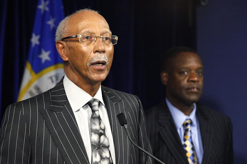 """FILE - In this Thursday, July 18, 2013 file photo, Detroit Mayor Dave Bing, left, speaks as state-appointed emergency manager Kevyn Orr listens during a news conference in Detroit. The decision to make Detroit the largest U.S. city to file for bankruptcy protection was tough to make, but it was the right one, Gov. Rick Snyder said Sunday, July 21, 2013, as he and Orr made the television talk show rounds. Bing, a first-term mayor who announced earlier this year he would not seek re-election in the fall, has been opposed to state oversight and bankruptcy. On Sunday, he told ABC's """"This Week"""" that he hopes the filing can be a new start for the city of about 700,000 people. (AP Photo/Paul Sancya, File)"""