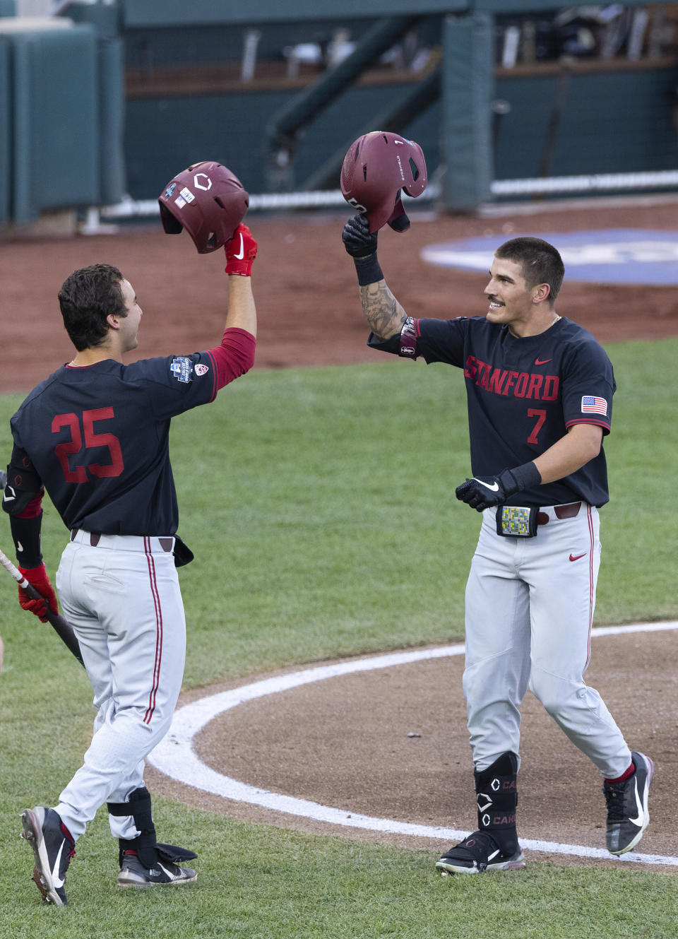 Stanford's Brock Jones (7), right, celebrates with Kody Huff (25) after hitting a home run in the third inning during a baseball game in the College World Series Wednesday, June 23, 2021, at TD Ameritrade Park in Omaha, Neb. (AP Photo/Rebecca S. Gratz)