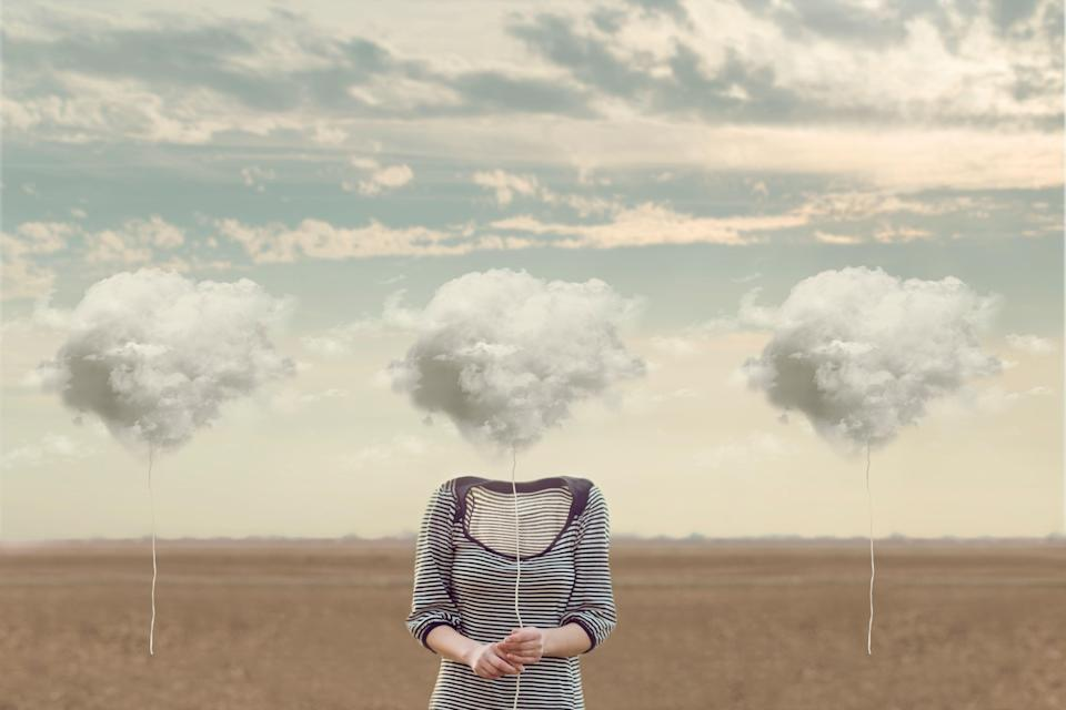 woman chooses her cloud to hide his face (Photo: fcscafeine via Getty Images/iStockphoto)