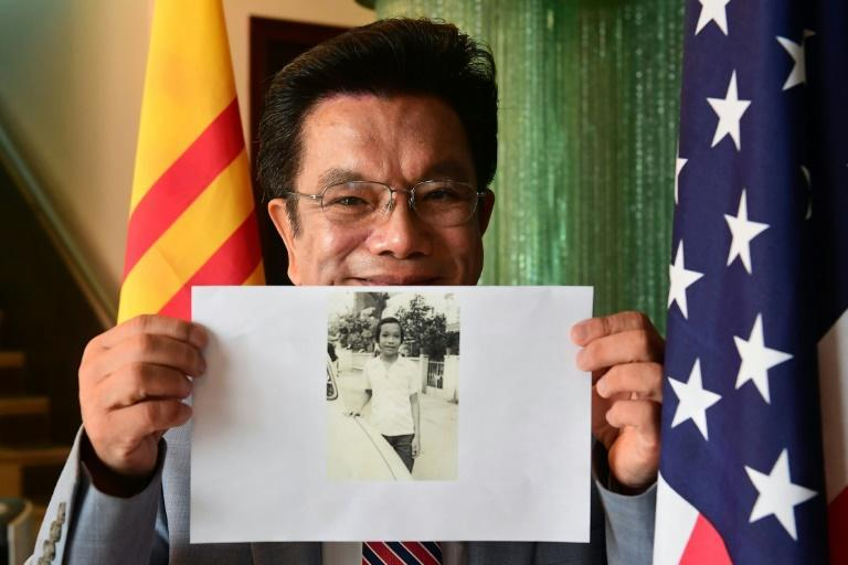 Phat Bui displays a photograph of himself as a young man in Vietnam, from his home in Garden Grove, California on August 23, 2021