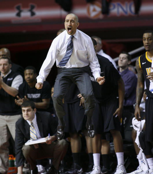 VCU coach Shaka Smart leaps as his team plays Temple in the first half of an NCAA College basketball game, Sunday, March 10, 2013, in Philadelphia. (AP Photo/H. Rumph Jr)
