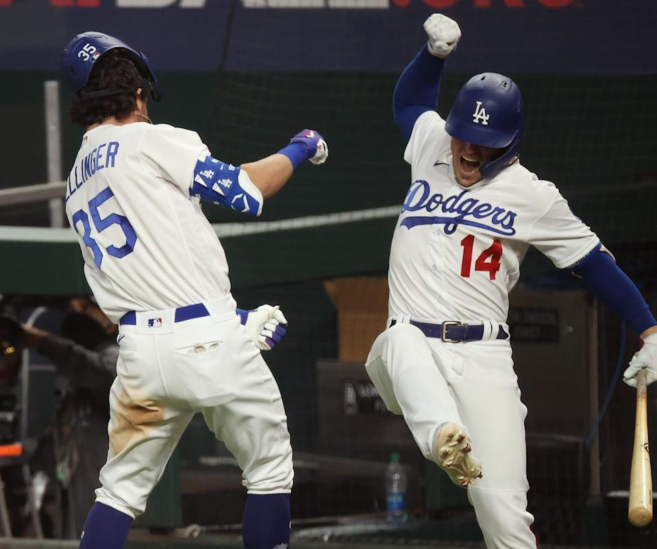 Bellinger celebrates his go-ahead home run with Kiké Hernandez in the seventh inning.