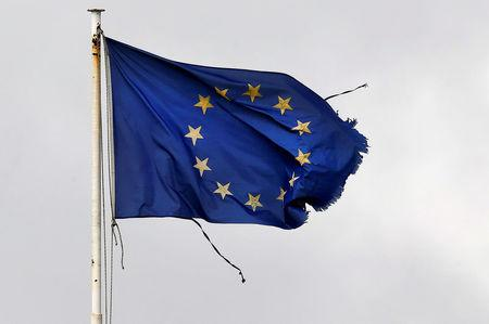 FILE PHOTO: A frayed EU flag flutters atop the Greek Ministry of Finance in central Athens
