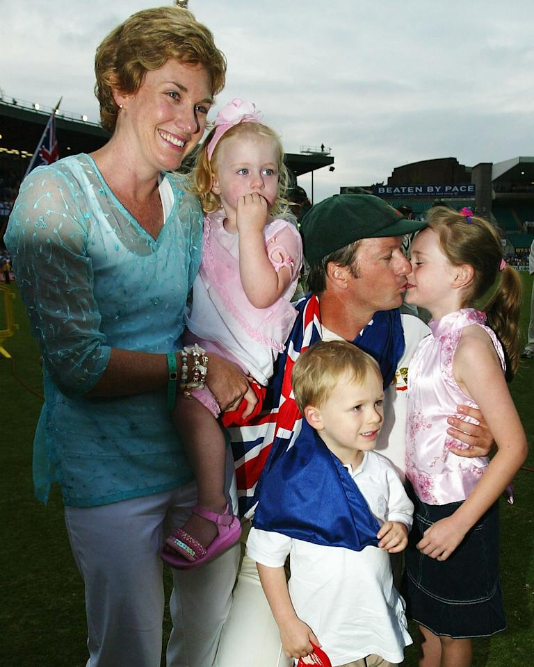 SYDNEY, AUSTRALIA - JANUARY 6:  Steve Waugh of Australia poses with wife Lynette and children Lily, Austinn and Rosie after retiring from Test Cricket on day five of the 4th Test between Australia and India at the SCG on January 6, 2004 in Sydney, Australia. (Photo by Hamish Blair/Getty Images)