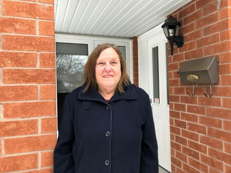 Bonnie Bowering, a supporter of changing her street name from 'Trump Avenue,' poses for a photo at her house in a west side neighborhood of Ottawa on January 26, 2021
