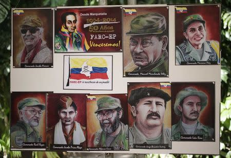 Paintings of the founders of Colombia's guerrilla group, the FARC, are seen during a news conference in Havana