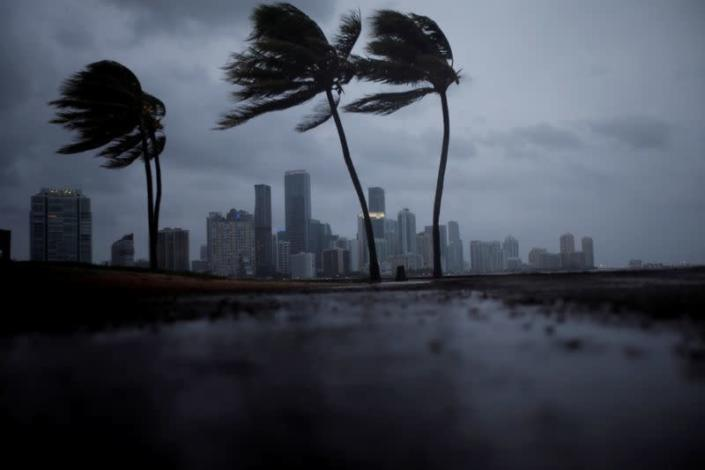 FILE PHOTO: Dark clouds are seen over Miami's skyline before the arrival of Hurricane Irma