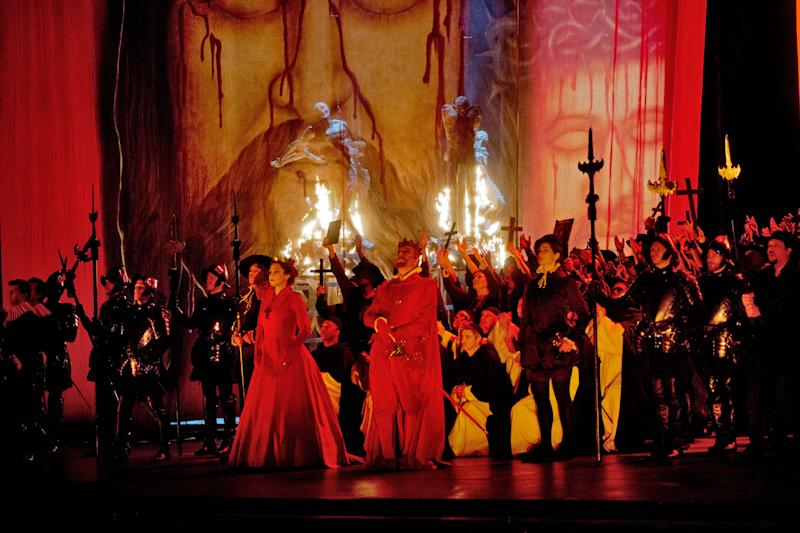 """In this Feb. 19, 2013 photo provided by the Metropolitan Opera, the cast fill the stage during a dress rehearsal of """"Don Carlo"""" at the Metropolitan Opera in New York. (AP Photo/Metropolitan Opera, Ken Howard)"""