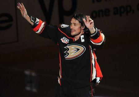 FILE PHOTO: April 13, 2014; Anaheim, CA, USA; Anaheim Ducks right wing Teemu Selanne (8) skates a lap following the 3-2 victory against the Colorado Avalanche in the overtime period at Honda Center. Mandatory Credit: Gary A. Vasquez-USA TODAY Sports
