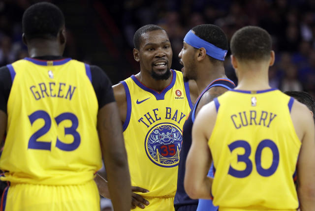 Golden State Warriors' Kevin Durant, center left, argues with Oklahoma City Thunder's Carmelo Anthony, center right, during the first half of an NBA basketball game Saturday, Feb. 24, 2018, in Oakland, Calif. (AP Photo/Marcio Jose Sanchez)