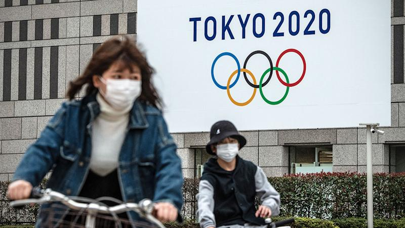 Locals in Tokyo wear face masks in response to the coronavirus pandemic.