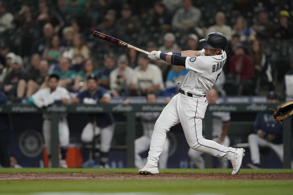 Seattle Mariners' Jake Bauers hits a go-ahead solo home run against the Minnesota Twins during the eighth inning of a baseball game, Monday, June 14, 2021, in Seattle. (AP Photo/Ted S. Warren)