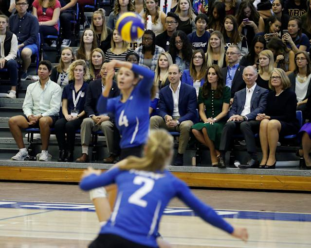 Britain's Prince William (seated front, 4th R) and Catherine, Duchess of Cambridge, watch women's volleyball at the University of British Columbia Okanagan in Kelowna, British Columbia, Canada, September 27, 2016. REUTERS/Chris Wattie