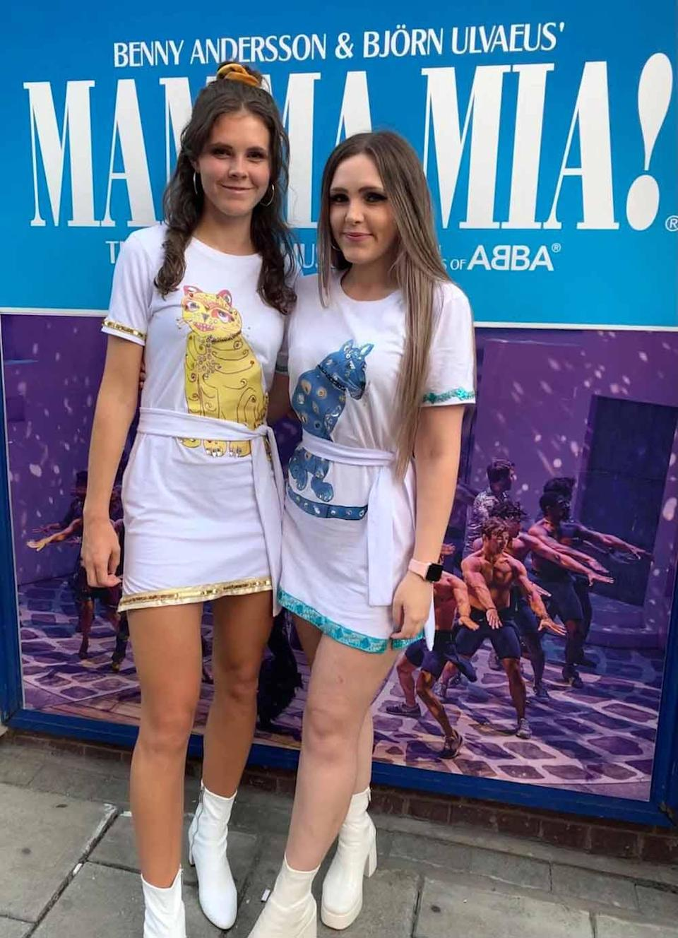 Chloe and Lucy in front of the Mamma Mia sign in September 2021 (Collect/PA Real Life).