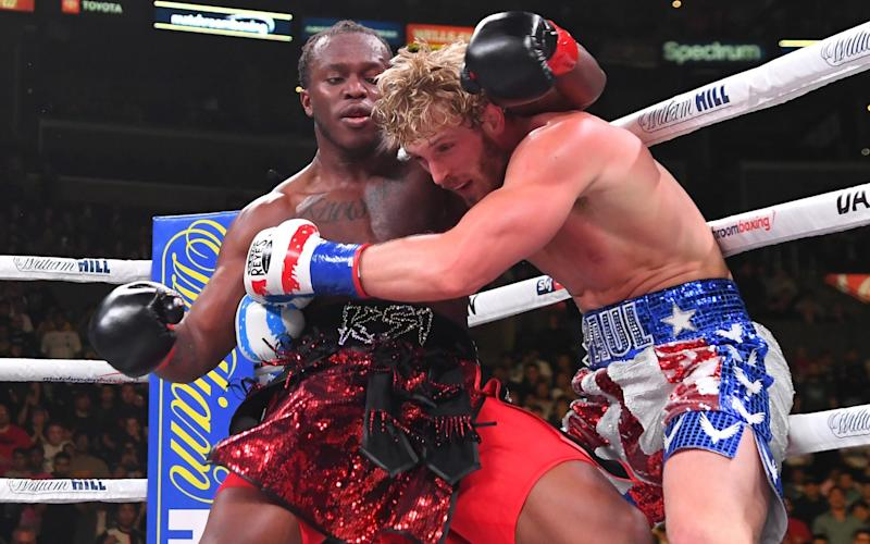 Logan Paul (right) and KSI exchange punches at Staples Center in November 2019 in Los Angeles - Jayne Kamin-Oncea/Getty Images
