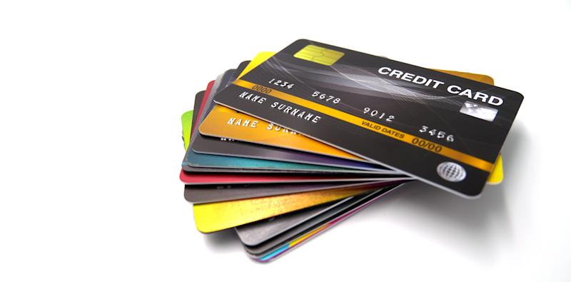 High Angle View Of Credit Cards Over White Background