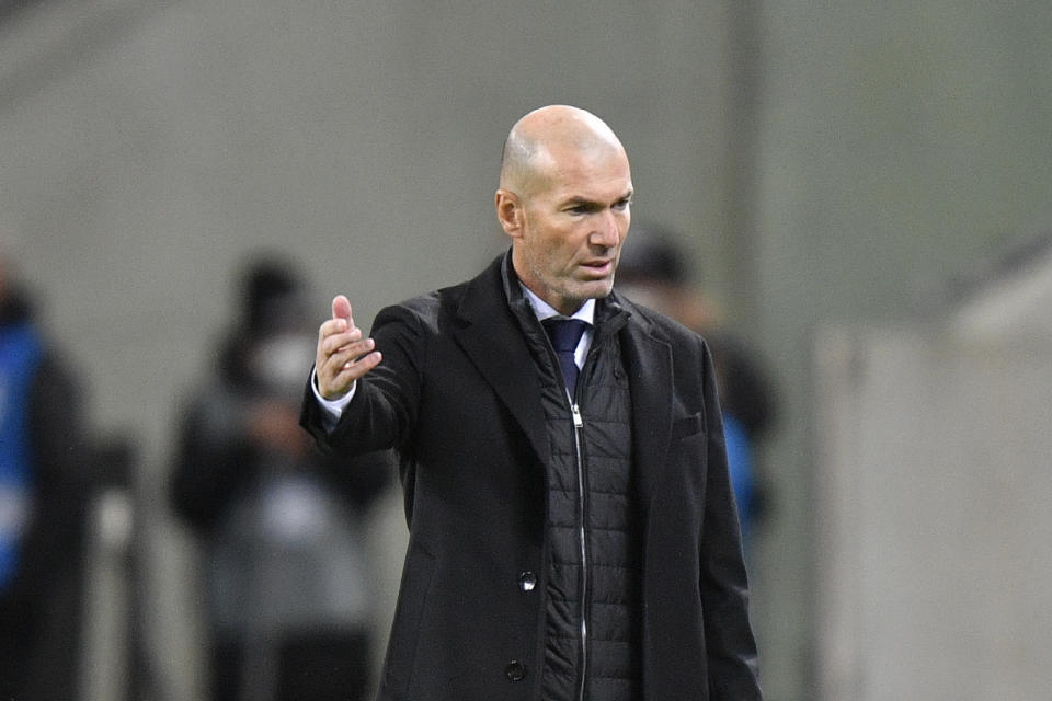 Real Madrid's head coach Zinedine Zidane gestures during the Champions League group B soccer match between Borussia Moenchengladbach and Real Madrid at the Borussia Park in Moenchengladbach, Germany, Tuesday, Oct. 27, 2020. (AP Photo/Martin Meissner)