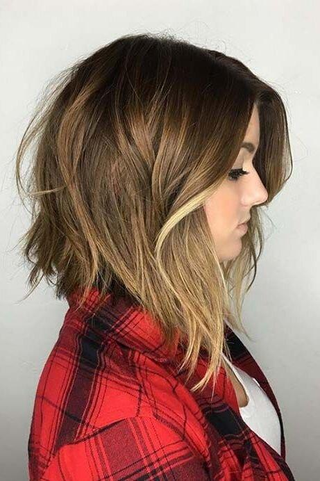 <p>If you don't want a super short cut but you want your hair to look thicker, go with an asymmetrical lob that's longer in the front than the back.</p>